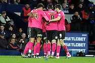 Peterborough players congratulate goalscorer Shaquile Coulthirst (unsighted). The Emirates FA Cup, 4th round match, West Bromwich Albion v Peterborough Utd at the Hawthorns stadium in West Bromwich, Midlands on Saturday 30th January 2016. pic by Carl Robertson, Andrew Orchard sports photography.