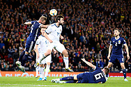 Scotland defender Liam Cooper (5) (Leeds United) challenges Georgy Dzhikiya of Russia (14) (Zenit St Petersburg) during the UEFA European 2020 Qualifier match between Scotland and Russia at Hampden Park, Glasgow, United Kingdom on 6 September 2019.