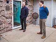 03 JANUARY 2020 - MONTEZUMA, IOWA: JOHN DELANEY, left, knocks on a door during a campaign visit to Montezuma, IA. Delaney, a former Democratic Congressman from Maryland, was the first Democrat to declare his candidacy for President in 2020, He has held more than 400 campaign events in Iowa since declaring his candidacy. Iowa traditionally holds the first selection event of the presidential election cycle. The Iowa Caucuses are Feb. 3.    PHOTO BY JACK KURTZ