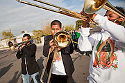 """Dec. 12, 2009 -- PHOENIX, AZ: Musicians perform during a procession to honor the Virgin of Guadalupe at St. Catherine of Siena Catholic Church in Phoenix, AZ. Most of the members of the church are Hispanic and Dec. 12, Virgin of Guadalupe Day, is one of the church's most important holy days. The Virgin of Guadalupe appeared to Juan Diego, a Mexican peasant, on Dec 9, 1531, on a hillside near Mexico City. She is the """"Queen of Mexico"""" and """"Empress of the Americas"""" and revered throughout Latin America.  Photo by Jack Kurtz"""