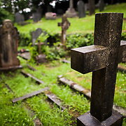 A cross-shaped headstone in the cemetary at St. Tanwg's Church in Harlech on Wales's northwestern coast, in Snowdonia.