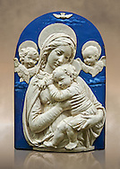 """Enamelled terracotta relief panel of the Virgin and Child with two cherubs a copy of the """"Madonna de l'Impuuneta"""" by Luca della Robbia, Florence 1399-1482).  Inv Campana 32,  The Louvre Museum, Paris. .<br /> <br /> If you prefer you can also buy from our ALAMY PHOTO LIBRARY  Collection visit : https://www.alamy.com/portfolio/paul-williams-funkystock/florentine-enamel-antiquities.html <br /> <br /> Visit our MEDIEVAL ART PHOTO COLLECTIONS for more   photos  to download or buy as prints https://funkystock.photoshelter.com/gallery-collection/Medieval-Gothic-Art-Antiquities-Historic-Sites-Pictures-Images-of/C0000gZ8POl_DCqE"""