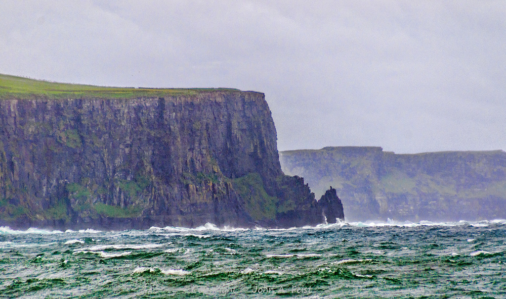 A forlorn look at the edge of the famous cliffs of Moher in County Clare, Ireland.  You can see how windy and rough the weather was that day.