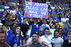 Birmingham City fans hold up a sign reading 'Che Adams please can I have your shirt' in the stands during the match