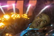 Un hombre ve desde su auto un espectáculo pirotécnico de la Feria Internacional de la Pirotecnia 2020.  /  A man stares at a pyrotechnic show while sitting in his car.