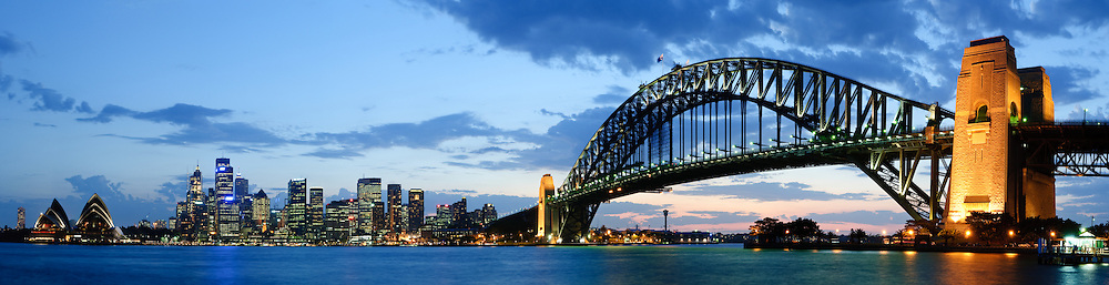High resolution panorama of Sydney city skyline overlooking Sydney Harbour. Sydney Harbour Bridge is at right and Sydney Opera House is at extreme left, with Circular Quay and the city in the middle.