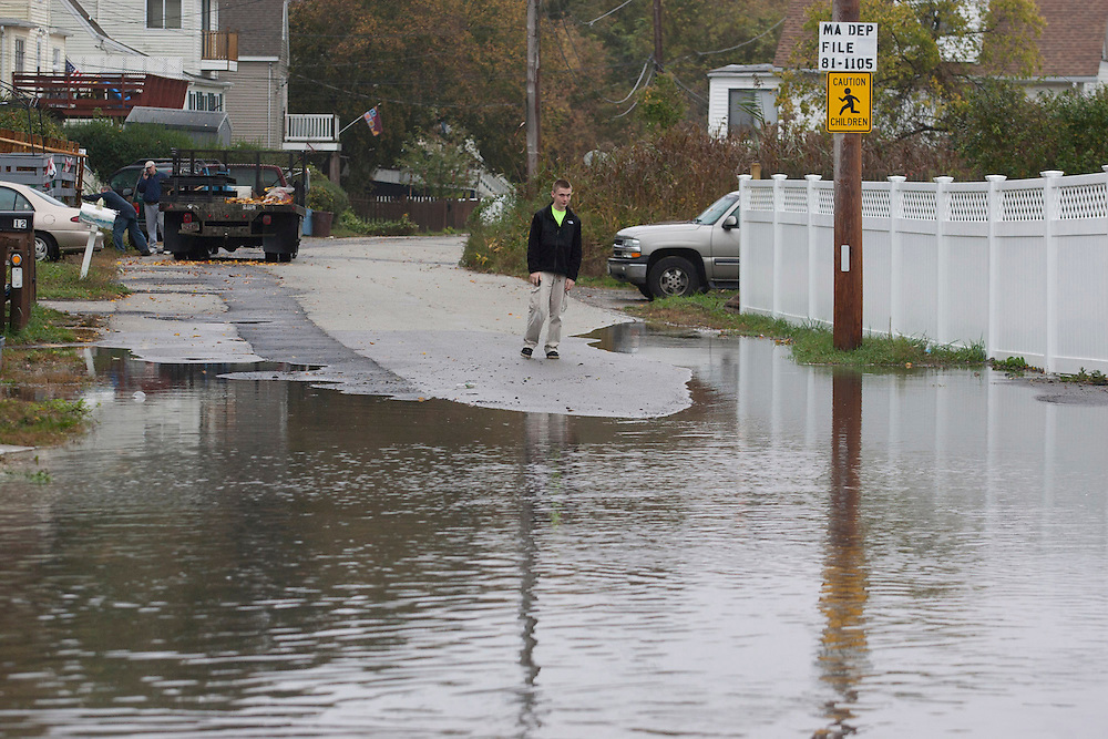 Weymouth, MA 10/29/2012<br /> A Weymouth resident looks at pooling seawater as Wessaugusett Rd in Weymouth at Wittaumet starts to flood under rising waters from Hurricane Sandy on Monday.