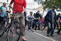 © Licensed to London News Pictures . 08/08/2011 . London , UK . People on the Pembury Estate in Hackney during a 3rd night of rioting and looting in London , which followed a protest against the police shooting of Mark Duggan in Tottenham . Photo credit : Joel Goodman/LNP