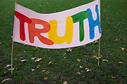 Extinction Rebellion climate change truth banner as sites around Westminster are blocked on 8th October 2019 in London, England, United Kingdom. Extinction Rebellion is a climate group started in 2018 and has gained a huge following of people committed to peaceful protests. These protests are highlighting that the government is not doing enough to avoid catastrophic climate change and to demand the government take radical action to save the planet.