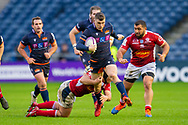 Mark Bennett (#13) of Edinburgh Rugby tries to break the tackle of Clement Martinez (#2) of SU Agen Rugby during the European Rugby Challenge Cup match between Edinburgh Rugby and SU Agen at BT Murrayfield, Edinburgh, Scotland on 18 January 2020.