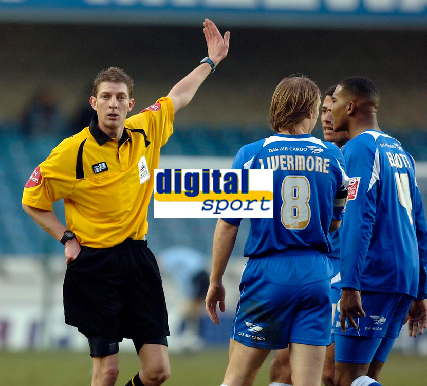 Photo: Daniel Hambury.<br />Millwall v Sheffield Wednesday. Coca Cola Championship. 04/02/2006.<br />Referee Steve Tanner waves away the protest of Millwall's players.