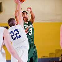 112912       Cable Hoover<br /> <br /> Thoreau Hawk Shanton Yazzie (3) shoots over the Santa Fe Prep Griffins defense during the Rehoboth Invitational Thursday at Rehboth High School.