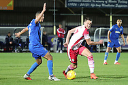 Stevanage attacker James Ball (7) taking on AFC Wimbledon striker Kweshi Appiah (9) during the EFL Trophy group stage match between AFC Wimbledon and Stevenage at the Cherry Red Records Stadium, Kingston, England on 6 November 2018.