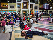 02 JANUARY 2019 - BANGKOK, THAILAND:      A man sleeps on the crowded floor of Hua Lamphong Train Station in Bangkok. The train and bus stations in Bangkok were crowded Wednesday with people going home after the long New Year's weekend.     PHOTO BY JACK KURTZ