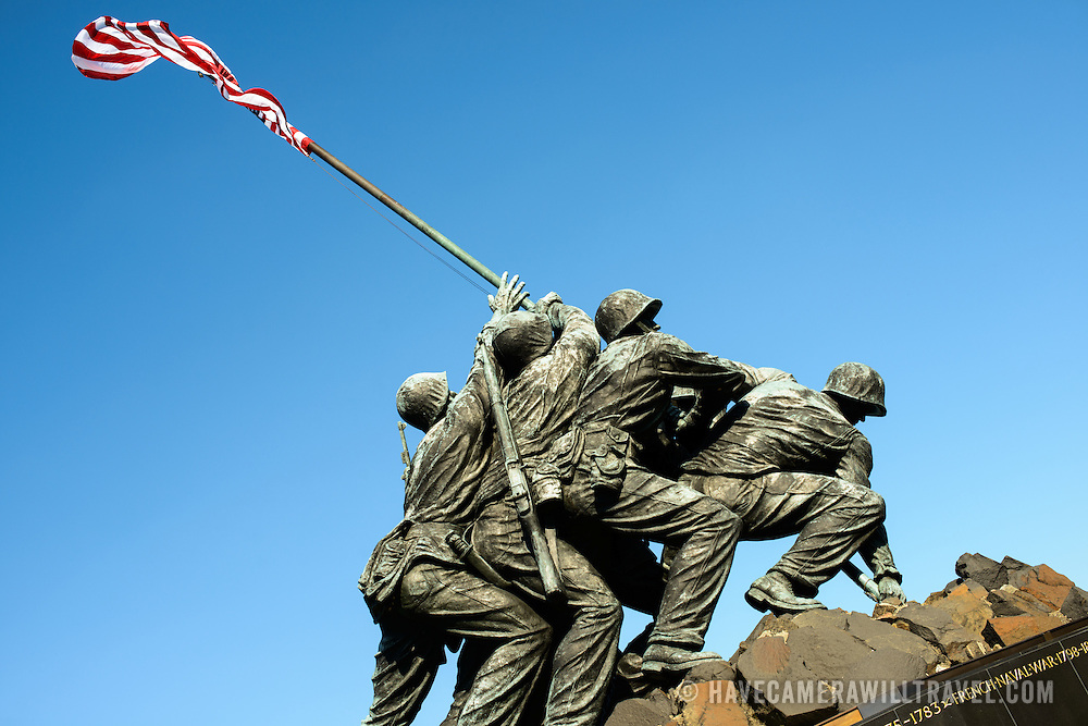 Statue on top of the Iwo Jima Memorial (formally the Marine Corps War Memorial) in Arlington, Virginia, next to Arlington National Cemetery. The monument was designed by Felix de Wledon and is based on an iconic Associated Press photo called the Raising the Flag on Iwo Jima by Joe Rosenthal. It was dedicated in 1954.