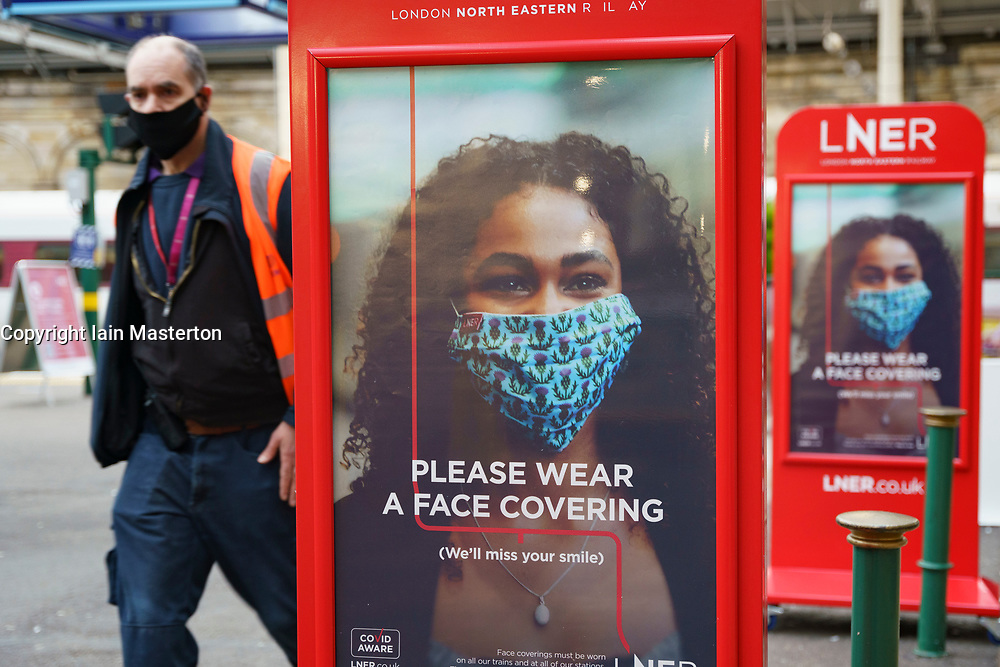 Edinburgh, Scotland, UK. 5 January 2020. Views of a virtually deserted Edinburgh City Centre as Scotland wakes up to the first day of a new strict national lockdown announced by Scottish Government to contain new upsurge in Covid-19 infections. Pic; Billboards inside Waverley railway station. Iain Masterton/Alamy Live News
