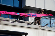 A climate change protester attaches a banner to barbed wire on a roof at London City Airport during day four of two weeks of planned demonstrations on 10th October, 2019 in London, Untited Kingdom. Extinction Rebellion is demanding that governments drastically cut carbon emissions.