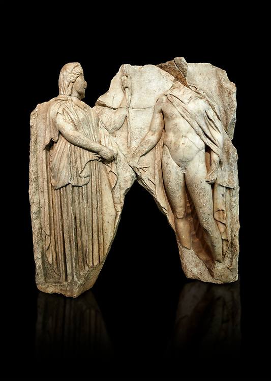 Roman Sebasteion relief  sculpture of Demeter and Triptolemos, Aphrodisias Museum, Aphrodisias, Turkey.   Against a black background.<br /> <br /> Deneter - stately, veiled and holding a sceptre - hands a bunch of wheat stalks to the young hero Trptolomos. Demeter was the grain goddess, and it was Triptolemos, a hero from Eleusis near Athens, whom she chose to bring grain cultivation to mankind .<br /> <br /> If you prefer to buy from our ALAMY STOCK LIBRARY page at https://www.alamy.com/portfolio/paul-williams-funkystock/greco-roman-sculptures.html . Type -    Aphrodisias     - into LOWER SEARCH WITHIN GALLERY box - Refine search by adding a subject, place, background colour, museum etc.<br /> <br /> Visit our ROMAN WORLD PHOTO COLLECTIONS for more photos to download or buy as wall art prints https://funkystock.photoshelter.com/gallery-collection/The-Romans-Art-Artefacts-Antiquities-Historic-Sites-Pictures-Images/C0000r2uLJJo9_s0