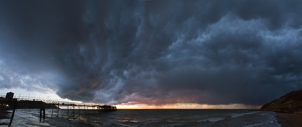 Stormy skies over Totland Bay.<br /> <br /> Panorama created from seven frames shot with the Sigma 10-20mm at f4.0 1/100<br /> <br /> Part of the Ocean Seen - Oceanic Photography Exhibition.<br /> <br /> Sponsored by Wightlink - Dimbola Museum & Galleries, Freshwater Bay, Isle of Wight - 29th June to 2nd September 2012.<br /> <br /> A collaborative summer show, bringing together three great oceanic photographers to celebrate the way we interact with our great British coastline.