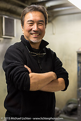 Custom bike builder Keiji Kawakita on a visit to his shop Hot Dock Custom Motorcycles after Mooneyes. Tokyo, Japan. December 8, 2015.  Photography ©2015 Michael Lichter.
