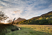 Grassy area on the banks of the River Leven, as it enters into Loch Leven close to Sunset.