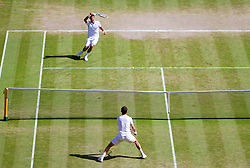 04.07.2014, All England Lawn Tennis Club, London, ENG, ATP Tour, Wimbledon, im Bild Novak Djokovic (SRB) plays the winning match-point past Grigor Dimitrov (BUL) to win the Gentlemen's Singles Semi-Final match 6-3, 3-6, 7-6 (2), 7-6 (7) on day eleven // during the Wimbledon Championships at the All England Lawn Tennis Club in London, Great Britain on 2014/07/04. EXPA Pictures © 2014, PhotoCredit: EXPA/ Propagandaphoto/ David Rawcliffe<br /> <br /> *****ATTENTION - OUT of ENG, GBR*****