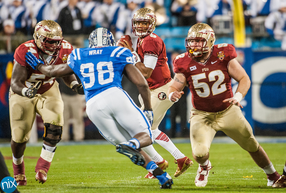 Florida State quarterback Jameis Winston looks to pass the ball against Duke during the ACC Championship game at Bank of America Stadium in Charlotte Saturday night. Florida State won the game 45-7.