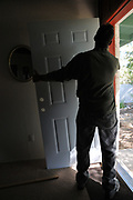 After removing my old front door, Hugh Goglin starts sizing the new door to the wall opening.