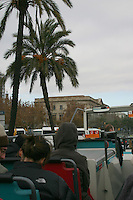 Open-top tourist bus travelling through Barcelona, Spain<br />