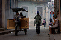 bike cart riding down havana streets