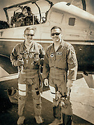 U.S. Air Force instructor pilots, photographed next to their Beechcraft T-6 Texan II turboprop trainer.  Dekalb Peachtree Airport (PDK), Atlanta.  <br />