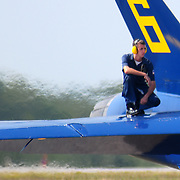 September 5, 2008 -- NAS BRUNSWICK, Maine. A crew member of the U.S. Navy Blue Angel flight squadron stands ready on the rear wing of Blue Angel 6 as the demonstration team prepares for their Friday's presentation of aerial precision at The Great State of Maine Airshow. The Airshow visited Naval Air Station Brunswick for the last time this weekend, bringing The U.S. Navy Blue Angels, The U.S. Army Golden Knights and a wide variety of static displays and interactive exhibits. The show drew over 150,000 people over three days with no mishaps among the performers and no emergencies among the attendees. .Because NAS Brunswick is scheduled to be closed in 2011 by the Base Realignment Commission, there will not be another Navy-sponsored airshow at this location. Yet, the Local Redevelopment Authority, responsible for managing the property after the departure of the Navy,  has included an airshow on a list of possible future uses for the property.  U.S. Navy Photo by Mass Communication Specialist 1st Class Roger S. Duncan (RELEASED)