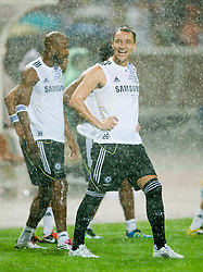 23.07.2011, Rajamangala National Stadium, Bangkok, THA, Chelsea FC Asia Tour, Training, im Bild // Chelsea's John Terry in a torrential downpour of rain during a training session at Rajamangala National Stadium in Bangkok on the club's preseason Asia Tour, EXPA Pictures © 2011, PhotoCredit: EXPA/ Propaganda/ D. Rawcliffe *** ATTENTION *** UK OUT!