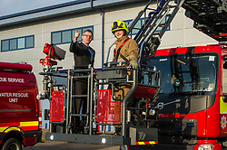 Pictured: Derek Mackay and turn table ladder crew leader Pete Emmerson<br /> Today Finance Secretary Derek Mackay visit the Scottish Fire and Rescue Services' East HQ in Edinburgh ahead of a meeting with other finance ministers  on VAT costs. During his tour of the facilities, the Finance Secretary spoke to firefighters and staff prior to hosting the Finance Ministers Quadrilateral where he will raise the issue of the GBP35 million annual VAT cost faced by Scottish police and fire services in contrast to other territorial police and fire services in the UK.<br /> <br /> Ger Harley | EEm 14 February 2017