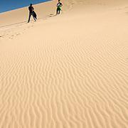 Two young men on huge Gobi desert sand dune (Yas Yu) (, Mongolia - Sep. 2008) (Image ID: 080905-1730431a)