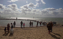 © Licensed to London News Pictures.27/03/2021. Southend-On-Sea,UK. Members of the public enjoy spring weather at the Thames Estuary in Southend-on-Sea, Essex. The weather forecasts predict sunny weather with strong winds in the southeast England.`Photo credit: Marcin Nowak/LNP