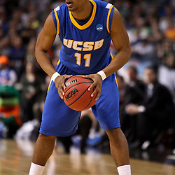 Mar 17, 2011; Tampa, FL, USA; UC Santa Barbara Gauchos guard Justin Joyner (11) during second half of the second round of the 2011 NCAA men's basketball tournament against the Florida Gators at the St. Pete Times Forum. Florida defeated UCSB 79-51.  Mandatory Credit: Derick E. Hingle