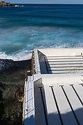 The empty Bondi Icebergs during a pool cleaning day. The contrast of the white empty pool with the blue ocean and textured dark rocks was appealing to capture.