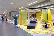 The Nova College in Haarlem has new energy-neutral Care education building and a multifunctional pavilion on its campus. Both were designed by Paul de Ruiter Architects . In addition, the office has redesigned the campus in collaboration with ZUS [Zones Urbaines Sensibles].<br /> <br /> In addition to the new buildings, the renewed Nova Campus consists of the existing main building of the Nova College, a regional training center at MBO level. The Care building, which covers six thousand square meters, houses the Care and Welfare courses, which together account for approximately 1,200 students. Paul de Ruiter designed the interior in collaboration with Firm architects.<br /> <br /> The study plazas, theory and practice rooms in the building are tailored to the specific needs of each study program. For example, the building has a completely reconstructed doctor and dental practice, and various nursing departments in which real care situations can be simulated. The practice room for pharmacist's assistant is also structured as a lifelike pharmacy with a pharmacy counter specially designed for the training.