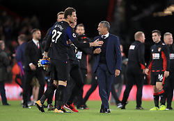 Brighton & Hove Albion manager Chris Hughton (right) speaks to AFC Bournemouth goalkeeper Asmir Begovic after the final whistle of the Premier League match at the Vitality Stadium, Bournemouth.