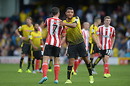 Shane Long of Southampton and Troy Deeney, the Watford captain hugging after the final whistle. Barclays Premier League, Watford v Southampton at Vicarage Road in London on Sunday 23rd August 2015.<br /> pic by John Patrick Fletcher, Andrew Orchard sports photography.