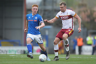 Charlie Wake is challenged by Callum Camps during the EFL Sky Bet League 1 match between Rochdale and Bradford City at Spotland, Rochdale, England on 21 April 2018. Picture by Daniel Youngs.