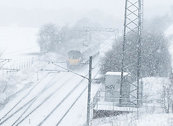Heavy Snowfall in West Lothian, Wednesday, 4th April 2018<br /> <br /> More heavy snow fell in West Lothian this afternoon causing traffic problems for drivers on the M8 Edinburgh to Glasgow motorway.<br /> <br /> A Scotrail train battles through the snow<br /> <br /> Alex Todd   EEm