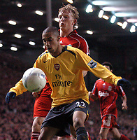 Photo: Paul Greenwood.<br />Liverpool v Arsenal. The FA Cup. 06/01/2007. Arsenal's Gael Clichy, foreground, shields the ball from Liverpool's Dirk Kuyt