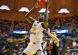 Jan 12, 2019; Morgantown, WV, USA; West Virginia Mountaineers forward Andrew Gordon (12) shoots during the second half against the Oklahoma State Cowboys at WVU Coliseum. Mandatory Credit: Ben Queen-USA TODAY Sports