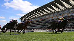 Jockey Joel Rosario on board Shang Shang Shang (right) leads the race at the Queen Anne Stakes during day three of Royal Ascot at Ascot Racecourse.