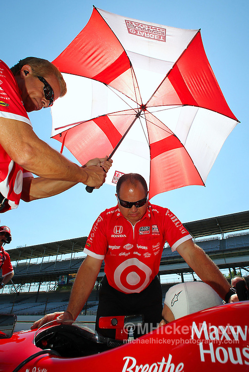 May 17, 2012; Indianapolis, IN, USA; The crew of IndyCar series driver Dario Franchitti assist him before practice for the Indianapolis 500 at the Indianapolis Motor Speedway.  Mandatory Credit: Michael Hickey-US PRESSWIRE