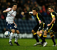 Photo: Paul Greenwood/Sportsbeat Images.<br />Preston North End v Cardiff City. Coca Cola Championship. 29/12/2007.<br />Cardiff's Gavin Rae (C) gets the ball past the chllenge of Lewis Neal
