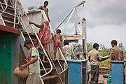 The local passenger ferry carries traders and farmers across the Padma River in Bangladesh.
