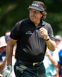 August 5, 2018 - Akron, OH, U.S. - AKRON, OH - AUGUST 05:   Phil Mickelson (USA) acknowledges the crowd after hitting his shot from the trees on the 6th hole during the final round of the World Golf Championships - Bridgestone Invitational on August 5, 2018 at the Firestone Country Club South Course in Akron, Ohio. (Photo by Shelley Lipton/Icon Sportswire) (Credit Image: © Shelley Lipton/Icon SMI via ZUMA Press)